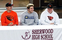 DAN BROOD - Sherwood High School seniors (from left) David Morris, Luka Nixon and Josh Bowcut signed their national letters of intent in front a big crowd at the school.