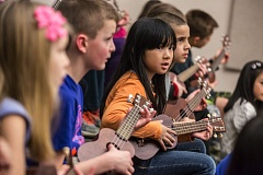 TIMES PHOTO: JONATHAN HOUSE - Second-grader Celina Vu plays the ukulele during music class at Alberta Rider Elementary School.