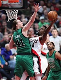 TRIBUNE PHOTO: JAIME VALDEZ - Trail Blazers forward Al-Farouq Aminu (right) challenges Boston's Kelly Olynyk en route to 26 points in 30 minutes Thursday night at Moda Center.