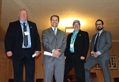 OUTLOOK PHOTO - From Left: Troutdale City Councilor Glenn White, Mayor Casey Ryan and Councilors Rich Allen and Randy Lauer take a break from the League of Cities' City Day event on steps in the Oregon Capitol Building on Wednesday, Feb. 8, in Salem.
