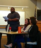 OUTLOOK PHOTO: CHRIS KEIZUR - East Metro Economic Alliance Executive Director Jarvez Hall, left, introduces Maggie Finnerty and Julianne Brands.
