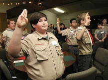 FILE PHOTO - Liam Campbell and his fellow Troop 127 Scouts recite the pledge.