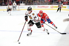 COURTESY: BRYAN HEIM/PORTLAND WINTERHAWKS - Portland Winterhawks defenseman Keoni Texeira races up the ice, beating Spokane forward Eli Zummack in a game against the Chiefs on Friday at Moda Center.