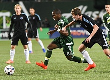 TRIBUNE PHOTO: JOSH KULLA - The Portland Timbers' Darlington Nagbe slices through the Minnesot United defense.