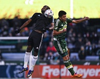 TRIBUNE PHOTO: JOSH KULLA - Marco Farfan (right) goes up for the ball against a Minnesota United player during Sunday's MLS preseason game for the Portland Timbers.