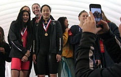 PMG PHOTO: MILES VANCE - It was picture time at the Three Rivers League district championship swim meet on Saturday at Mt. Hood Community College Aquatic Center, where Lakeridge's (clockwise from bottom left) Skye Buck, Mara Newman, Brynne O'Shea and Ariana Chin get the star treatment after winning the day's first event, the 200-yard medley relay. The Pacers and the rest of Oregon's best will be back at MHCC for the Class 6A state meet on Friday and Saturday.