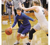 SETH GORDON - Senior point guard Taylor Rarick races to get past a Canby defender during Newberg's 62-46 road loss to Canby. Rarick scored a game-high 28 points.