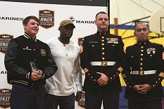 PHIL HAWKINS - Gervais senior Peter McKinley (left) stands with former University of Oregon cornerback Ifo Ekpre-Olomu and Marines Russell Mullis and Rafael Yumo after receiving the MaxPreps National Athlete of the Month award at an assembly on Friday at Gervais High School.