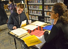 TIDINGS PHOTOS: VERN UYETAKE - Luke Van Sickle takes a history of magic exam during West Linn Librarys Harry Potter Night event Feb. 10.