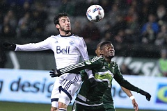 TRIBUNE PHOTO: JAIME VALDEZ - Dairon Asprilla of the Portland Timbers battles for a ball in the air, and in the rain, Wednesday night against Vancouver at Providence Park.