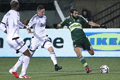 TRIBUNE PHOTO: JAIME VALDEZ - Portland Timbers midfielder Diego Valeri beats two Vancouver Whitecaps player who are late in disrupting his pass Wednesday night at Providence Park.