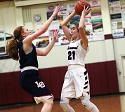 DAN BROOD - Sherwood junior Lauren Scarvie (right) is guarded by Lake Oswego senior Gillian Mair in Friday's game.