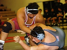 DAN BROOD - Tualatin High School senior Anthony Carpio-Reyes (left) takes control in his 285-pound match against Lake Oswego's Issac Ziebell. Carpio-Reyes won the match by fall.