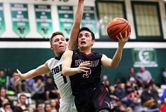 DAN BROOD - Tigard High School senior guard Luke Smith (left) plays tight defense against Tualatin senior Hayden Deuna as he tries to go up to the basket in Tuesday's game.