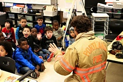 CONTRIBUTED PHOTO - A Portland firefighter speaks to students at Alder Elmentary School about fire safety and what takes place in her job.