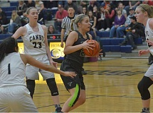 HERALD PHOTO: COREY BUCHANAN - Tigard guard Kylie Warren hit key free throws and scored a game-high 21 points against Canby.