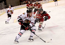COURTESY: BRYAN HEIM/PORTLAND WINTERHAWKS - Portland forward Alex Overhardt keeps the puck from Red Deer defenseman Carson Sass.