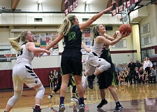 PMG PHOTO: MILES VANCE - Sherwood's Aubrie Emmons breaks between two defenders during her team's 26-23 loss to West Linn at Sherwood High School on Friday night.