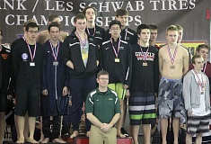 PMG PHOTO: MILES VANCE - The Jesuit boys swim team's 200-yard freestyle relay team (center, behind coach Bryan Butcher) helped the Crusaders win the Class 6A state championship on Saturday at Mt. Hood Community College Aquatic Center.