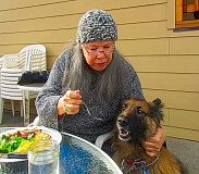 ERIC NORBERG - Kimberly Koehler with BEE staffmember Sable - a long haired German Shepherd, and a very well behaved diner - together, on the porch of the Brooklyn House Restaurant for Sunday Brunch on January 29.