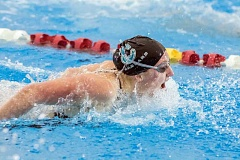 HILLSBORO TRIBUNE PHOTO: CHASE ALLGOOD - Century's Riley Neal competes in the 100 yard butterfly at last weekend's OSAA State Swimming Championships at Mt. Hood Community College.