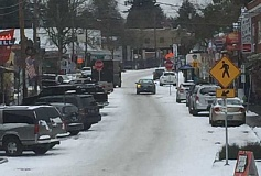CONTRIBUTED PHOTO - Multnomah Village after some recent snow. Sip D'Vine's owner Jill Crecroft said after a storm turns the road icy, 'you can shoot a cannon down Capitol Highway and it won't hit anyone.""