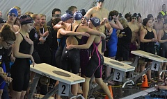 TIMES PHOTO: MATT SINGLEDECKER - The Sunset girls swimming teams 400-yard freestyle relay celebrates its win over Jesuit at the Class 6A state championship meet.