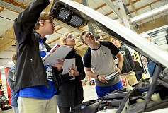 REVIEW PHOTO: VERN UYETAKE - Automotive students peer under the hood. From left: Alec Senner, junior, LOHS; Abby Bernasconi, senior, Lakeridge; Edward Mahoney, junior, Lakeridge.