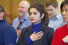 PORTLAND TRIBUNE: JAIME VALDEZ - Monica Gupta recites the Pledge of Allegiance during a recent naturalization ceremony at the Beaverton Library.