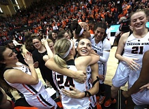 TRIBUNE PHOTO: JAIME VALDEZ - Oregon State's Gabriella Hanson hugs fellow senior guard Sydney Wiese (24) after the Beavers'  50-47 victory over Stanford on Friday at Gill Coliseum.