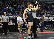 REVIEW PHOTO: MILES VANCE - Lakeridge sophomore Quinn Brink smiles as he has his hand raised after winning the Class 6A state championship at 126 pounds on Saturday at Veterans Memorial Coliseum on Saturday.
