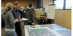 SPOKESMAN PHOTO: CLAIRE GREEN - The Willamette River room at City Hall was packed Feb. 22 for the French Prairie Bridge Open House. More than 70 people attended the event to view the proposed plans.