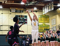 TIDINGS PHOTO: MILES VANCE  - West Linn senior Nolan Bertain launches a three-pointer during his team's 98-45 win over Madison in the first round of the Class 6A state playoffs at West Linn High School on Tuesday.