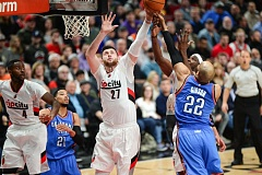 TRIBUNE PHOTO: JOSH KULLA - Trail Blazers center Jusuf Nurkic goes for the ball Thursday night at Moda Center.
