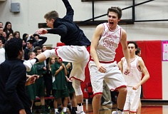PMG PHOTO: DAN BROOD - Westview seniors Zach Sly (55) and Trevor Laakso celebrate followng the Wildcats' 49-46 win over Tigard in Friday's state playoff game.