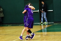 DAN BROOD - Sunset seniors Rose Pflug (left) and Maddie Muhlheim hug following the Apollos' 56-49 win over Tigard in Saturday's state playoff game.
