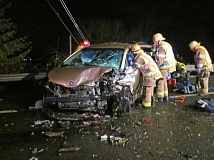 PHOTO COURTESY OF WASHINGTON COUNTY SHERIFF'S OFFICE - Crews work to save the life of a Tigard driver Monday night on Scholls-Sherwood Road.