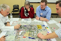 SPOKESMAN PHOTO: CLAIRE GREEN - (Left to right) Doug Seely, Hilly Alexander, Josh Benton and MIG consultant Alex Dupey marked up an aerial map with development issues, key existing features and future hopes for the area.