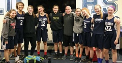 SUBMITTED PHOTO - The Lake Oswego Junior High eighth-grade girls team included (left to right) Allison Sweeney, Kilyn Dawkins, Janie Ruttert, Emma Jeanson, Macy Douglass, coach Kyle Stanley, Kate Anders, Elle Lockard, Alexandra Stearns and Sarah Novitsky.