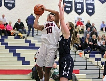REVIEW PHOTO: MILES VANCE - Lake Oswego senior guard/forward Morgan McKinney won a berth on the all-Three Rivers League first team this year.