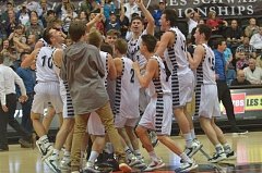 SPOKESMAN PHOTO: COREY BUCHANAN - Wilsonville celebrates after winning the state title game over Churchill Friday, March 10.