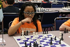 TRIBUNE PHOTO: LYNDSEY HEWITT - Fifth grader Devina Shrestha, of Mary Woodward Elementary School in Tigard, contemplates her next move at the 50th annual Chess for Success tournament on Saturday at the Oregon Convention Center.