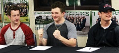 DAN BROOD - Tigard High School seniors (from left) Hunter Hughes, Connor Wojahn and Brett Thomas recently signed their national letters of intent.