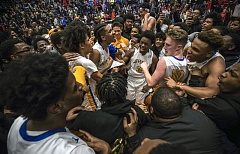 TRIBUNE PHOTO: JONATHAN HOUSE - Fans surround the Jefferson Democrats on the court at Chiles Center moments after they won the Class 6A championship boys basketball game against Clackamas, 70-67.