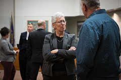 FILE - Kathy McAlpine, center, talks to an attendee at an open house for Tigard police chief candidates in late January. McAlpine was selected from among the six finalists at that event to lead the Tigard Police Department, the city announced Monday.
