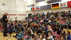 SUBMITTED PHOTO - Assistant Principal Jere Applebee leads an assembly with students at John Wetten Elementary School. Starting July 1, he will serve as the Gladstone School District's director of early learning.