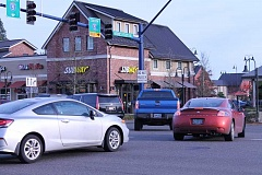 SPOKESMAN PHOTO: CLAIRE GREEN - At the corner of Wilsonville Road and Boones Ferry, cars hoping to escape the afternoon traffic and make the light often stack across the intersection. When congestion is at a high, many of these vehicles get stuck in the intersection, blocking traffic in other directions.