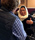 PAMPLIN MEDIA GROUP: PETER WONG - Salma Ahmad of Cedar Mill, president of the Islamic Society of Greater Portland, speaks with Paula DiNovo (back to camera) after talk Monday, March 13, at the Washington County Public Affairs Forum.