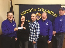 SUBMITTED PHOTO - Duane Kloser, Grand Knight of the Canby Knights of Columbus (left) presents a check for $15,000 to Lee Ann and Chris Mead from Sparks of Hope. The money was raised at the recent Crab Dinner and Charity Auction held at the Clackamas County Fairgrounds.