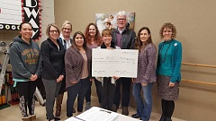 COURTESY PHOTO - (Left to right back row) Catherine Williams, Margie Petersen, Jennifer BeLusko, Rainy McLoud, Lenika Hutchens and Stephanie Lind and (from left to right front row) Michelle Robles and Patty Petersen received a check from Forest Grove/Cornelius Chamber of Commerce President Howard Sullivan last week to help fund dance scholarships.